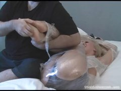 Babe bound in plastic wrap giggles whilst tickled