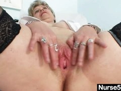 Busty granny in uniform stretching her mature pussy
