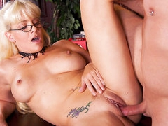 Blonde haired four-eyed milfy librarian Heidi Mayne has a wonderful time egtting her bald neat pussy drilled by horny hard dicked dude after she blows his dick. That babe has sexy tattoos all over her hot body.