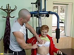 watch this mature woman touching his big cock