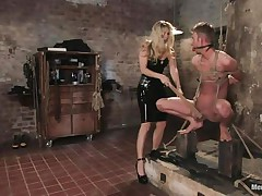 blonde mistress inducing pain to her sex thrall