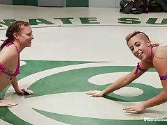 lesbian chicks fighting in the wrestling arena