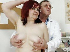 doctor taking a close look at her vagina.